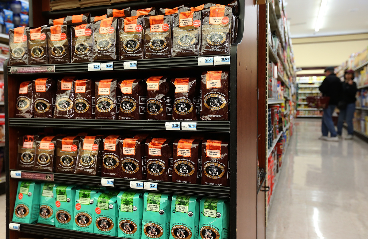 Packages of coffee beans are displayed at Cal-Mart Grocery
