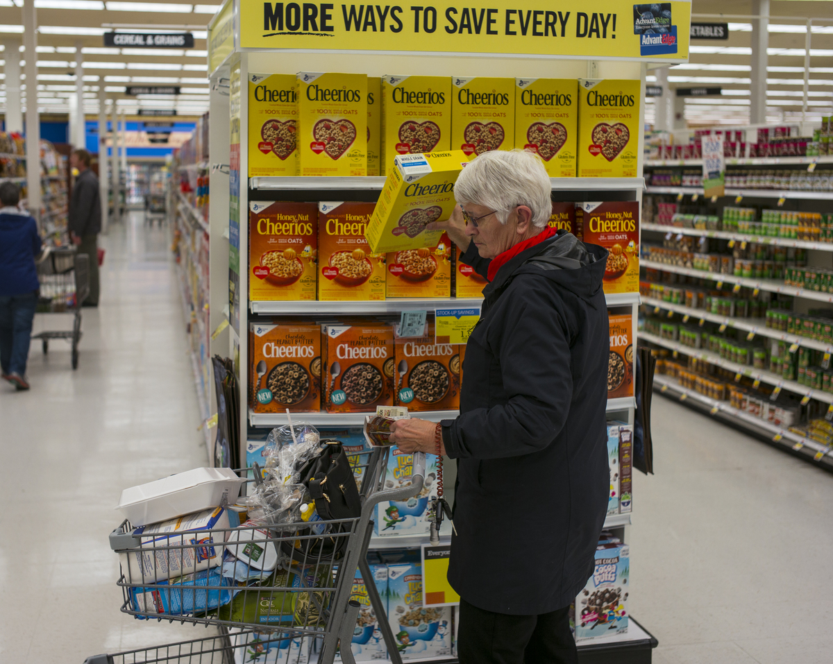 A woman shops for Cheerios cereal at a Price Chopper supermarket
