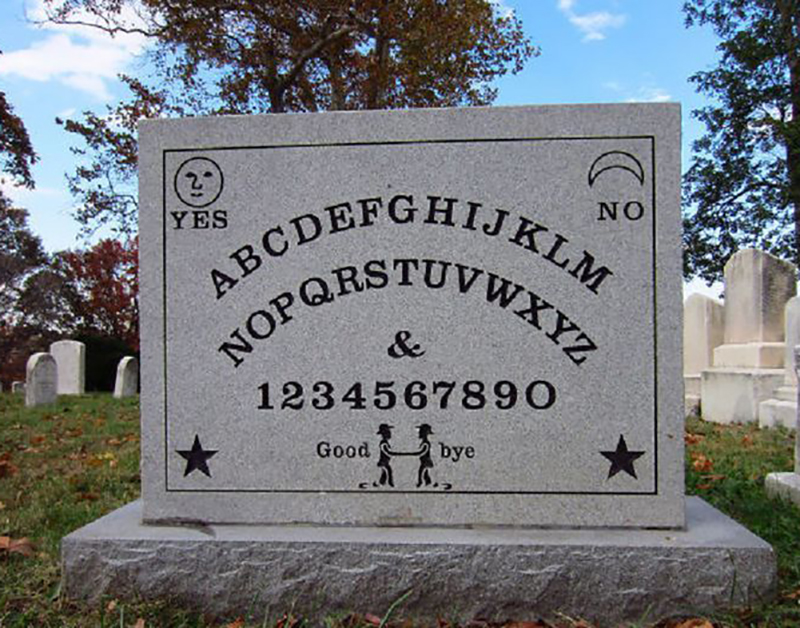 A headstone is made to look like a ouiji board
