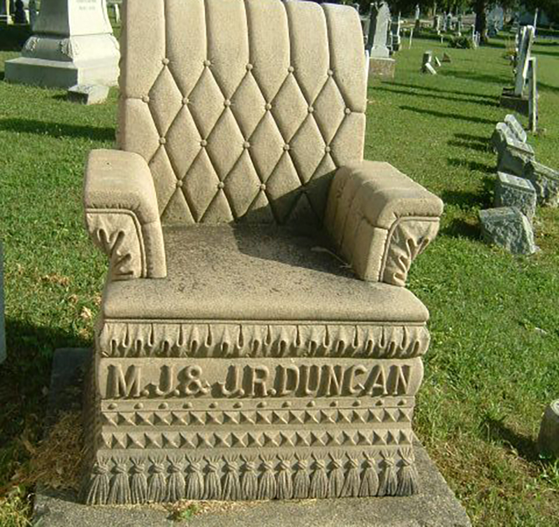 A headstone is shaped like a lounge chair
