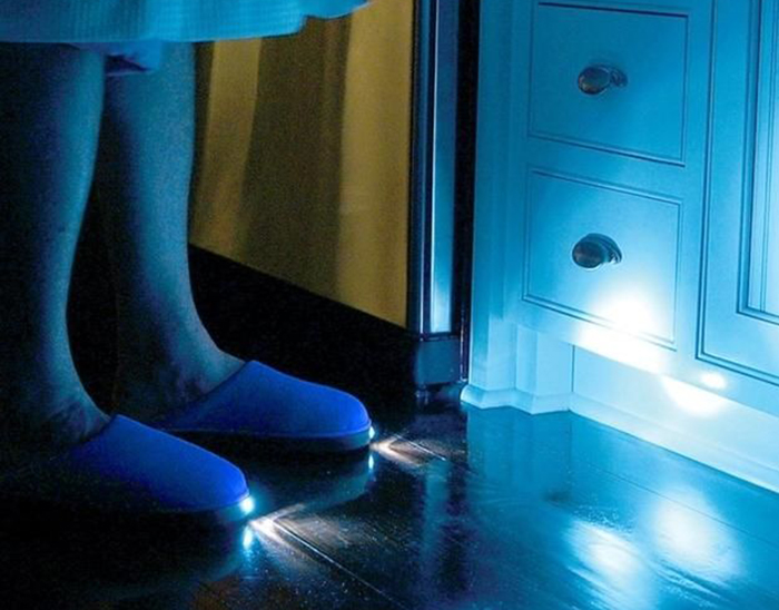 Woman wears slippers with an LED light on the toe