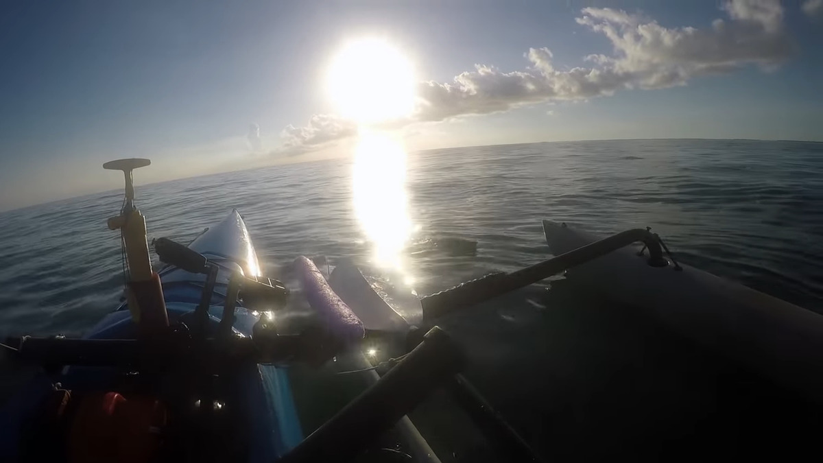 kayak fisherman sees something floating in the water in florida