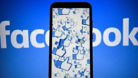 The Facebook likes logo are seen displayed on an Android mobile phone