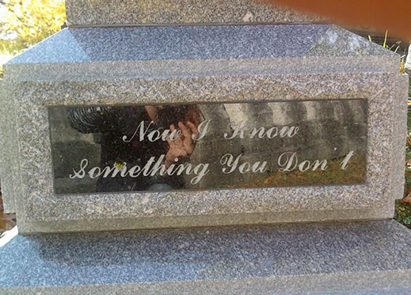 "A headstone reads ""Now I know something you don't"""