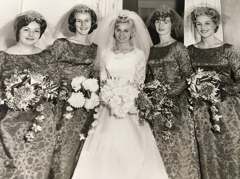Marguerite poses with her bridesmades
