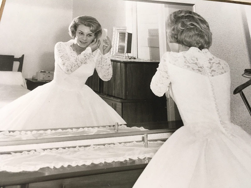 Marguerite looks in the mirror and prepares for her wedding