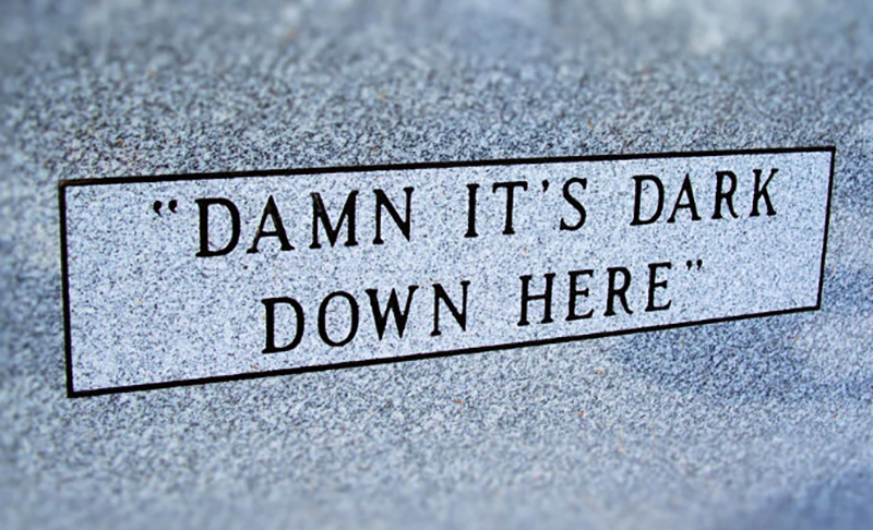 "A headstone reads ""damn it's dark down here"""