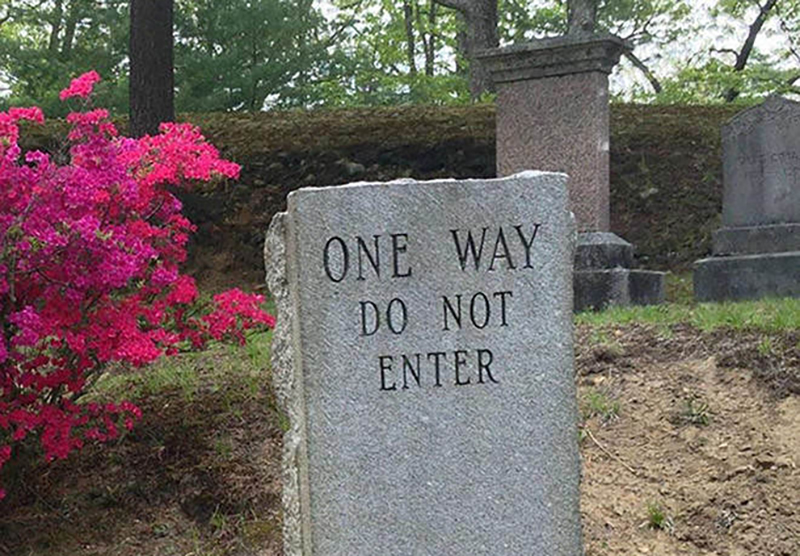 "A headstone reads ""one way do not enter"""