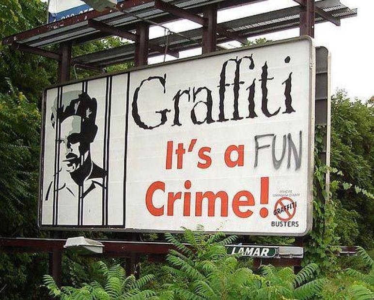 A billboard calling graffiti a crime has the word