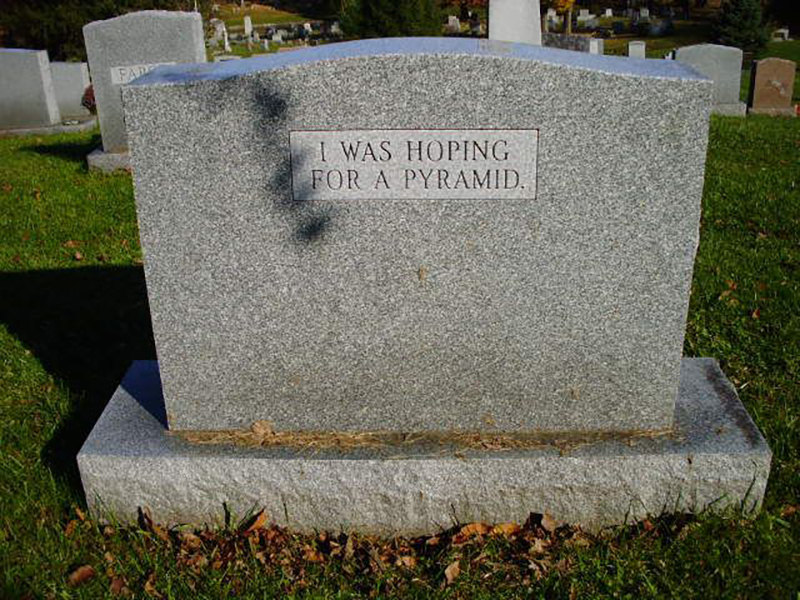 "A headstone reads ""I was hoping for a pyramid"""
