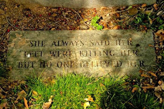 A headstone states that no one believed when the deceased said her feet were killing her