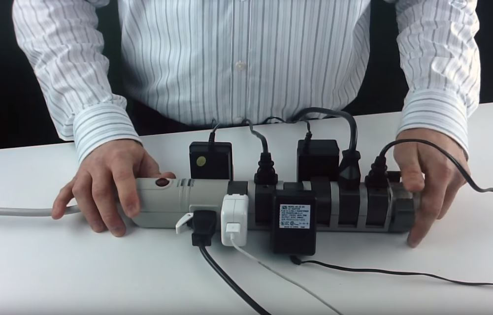 Quail Electronics employee shows off a rotating power strip