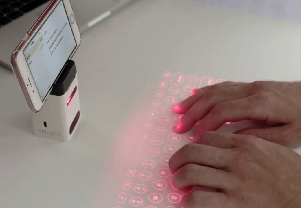 Person tests out a virtual keyboard that connects to their iPhone