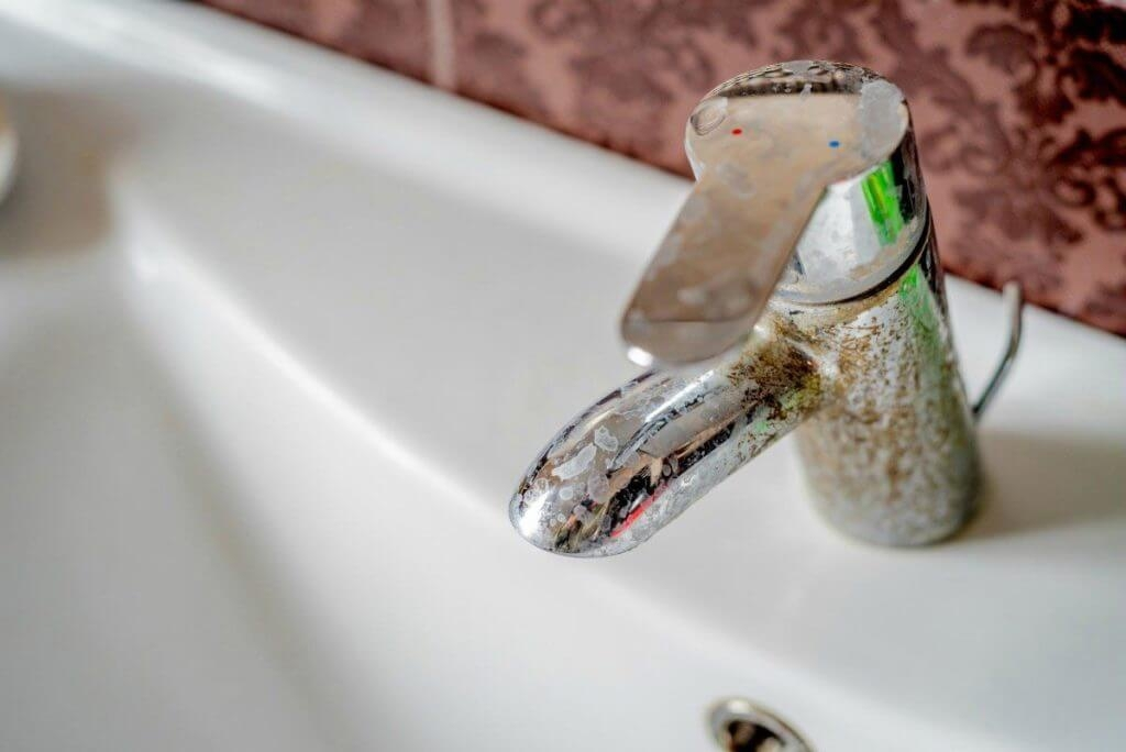 Hard water stain on faucet