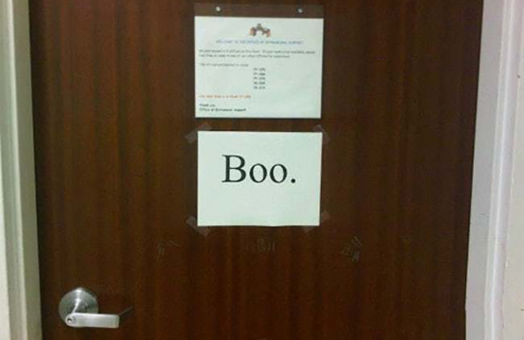 Boo! sign taped to the wall
