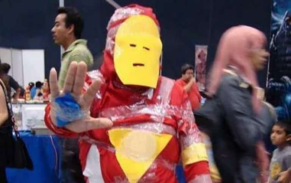 Man dressed up as Iron Man in paper and tape