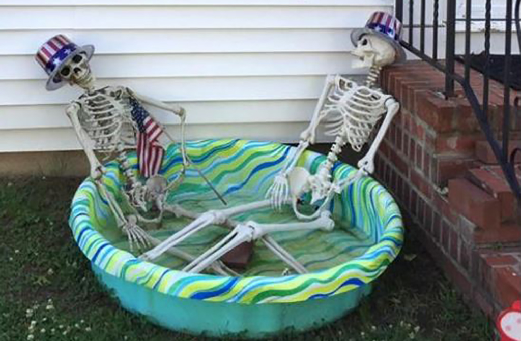 Skeletons in fourth of July costumes