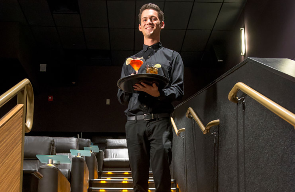 Movie employee with drinks