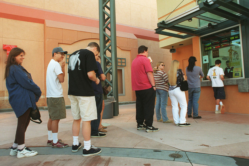 Customers in line to buy tickets