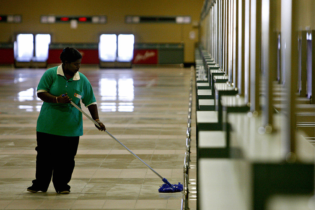 Woman mopping the floors