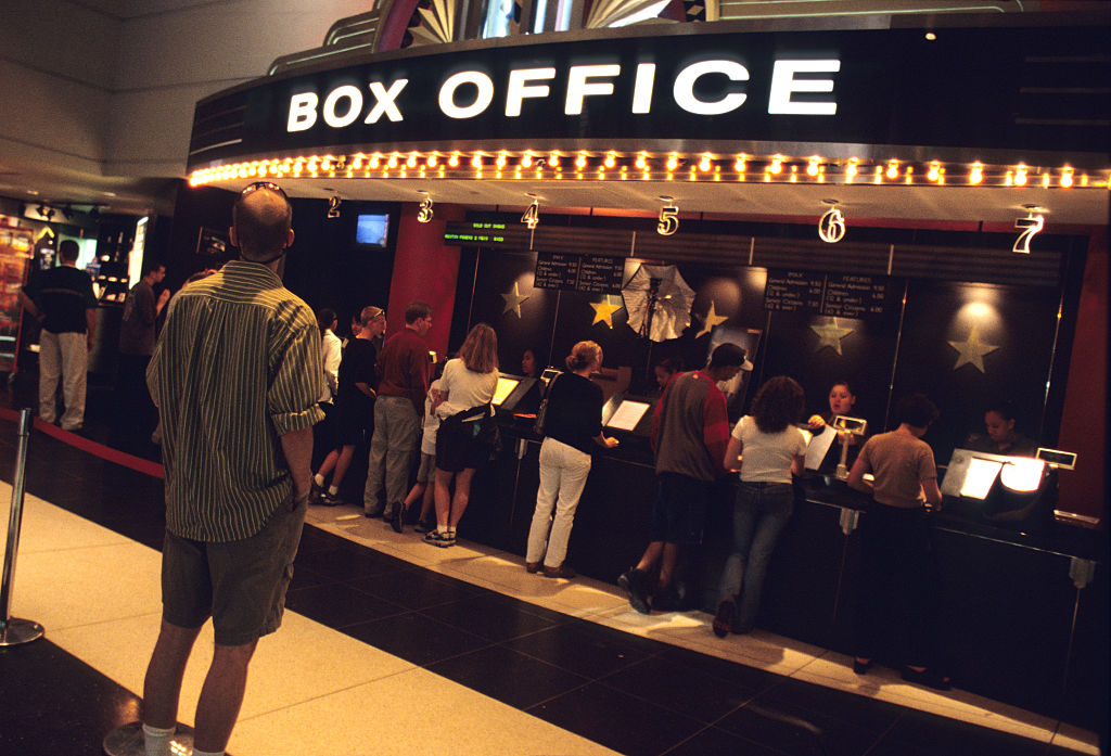 People buying tickets at the box office
