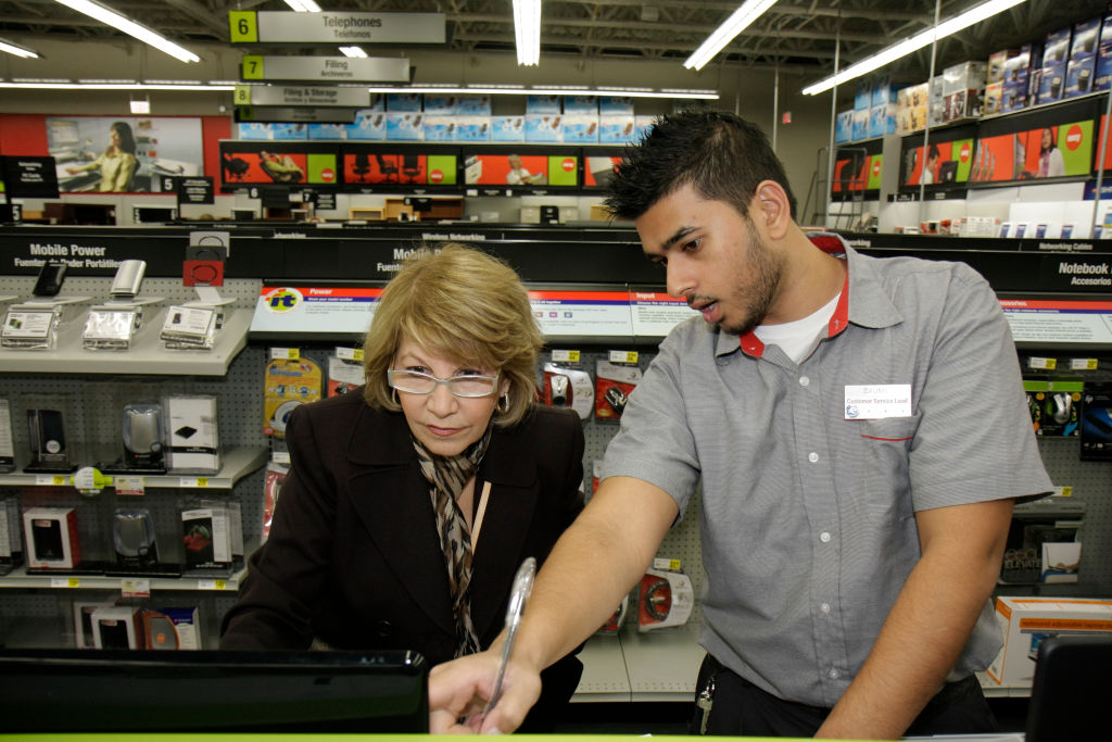 Clerk helping a woman