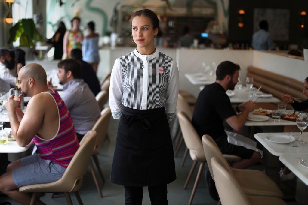 Waitress waiting to help someone