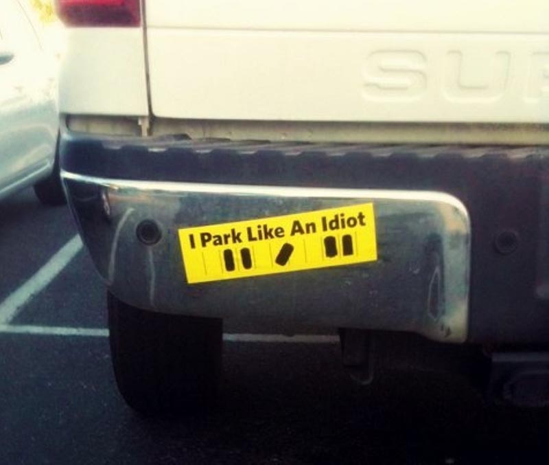 A bumper sticker shows the image of a car parked diagonally and warns