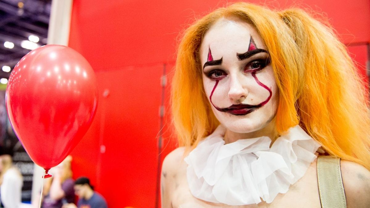 A cosplayer in character as Pennywise from IT seen during Day 2 of the MCM London Comic Con 2018