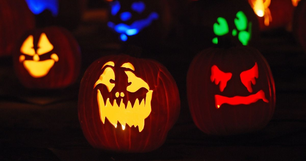 Carved pumpkins are displayed and lit up.
