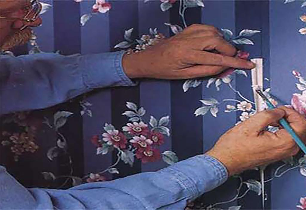 Man fixing wallpaper