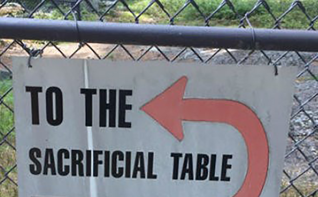 Sacrificial table sign
