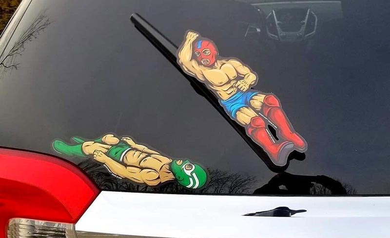 Two wrestler stickers are arranged on the back window so that when the wiper goes down it appears that they are fighting.