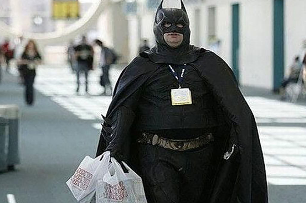 Man dressed as batman with takeout food