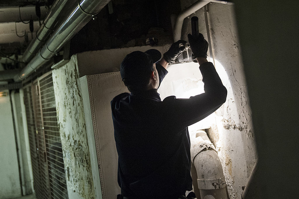 A policeman is pictured as he looks for kits used by drug dealers during a patrol in the tunnels
