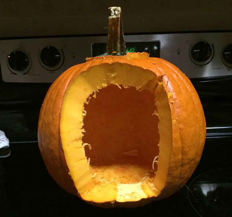 Pumpkin with a large hole cut into its side