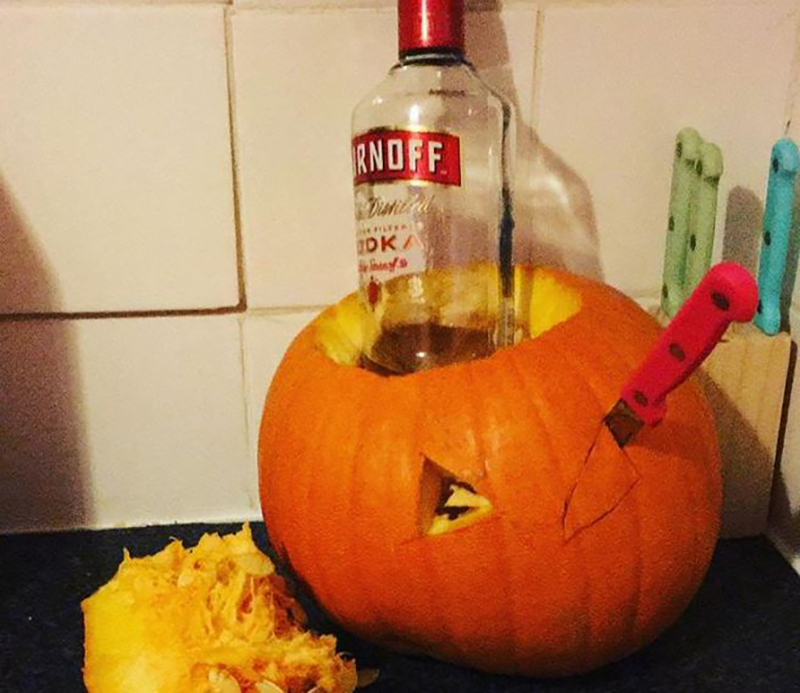 Failed pumpkin carving is repurposed as a vodka container