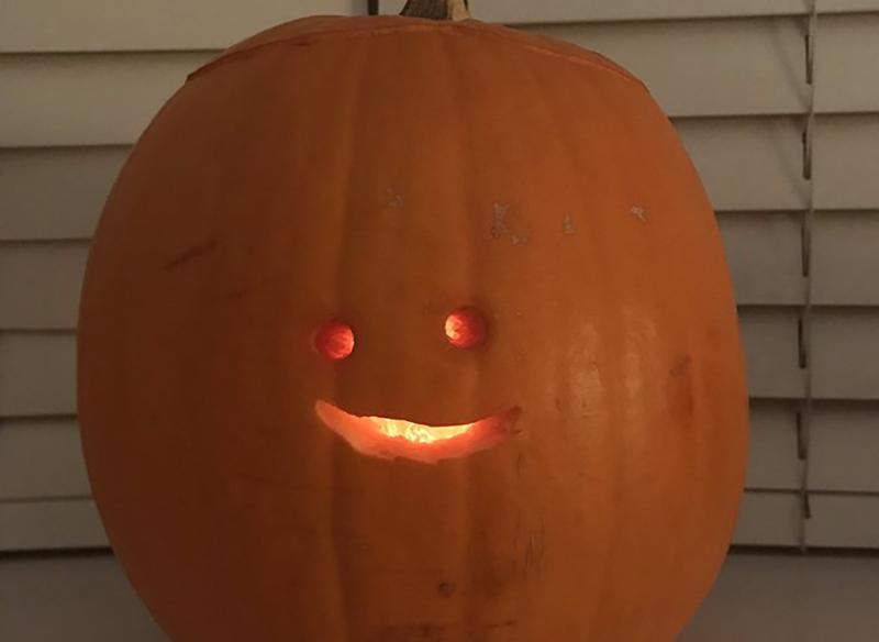 Jack-o'-lantern with tiny happy face