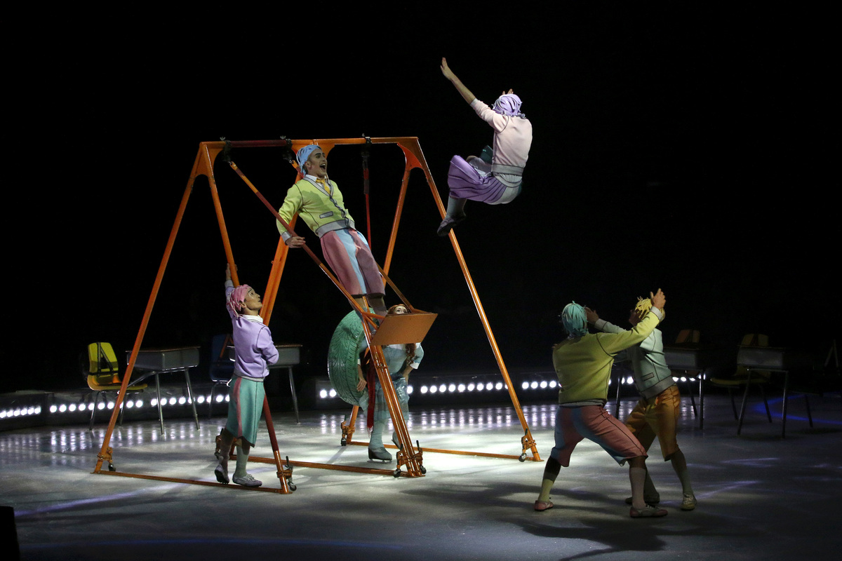 Acrobats on ice perform their act during a preview opportunity for the press ahead of the Cirque Du Soleil show 'CRYSTAL
