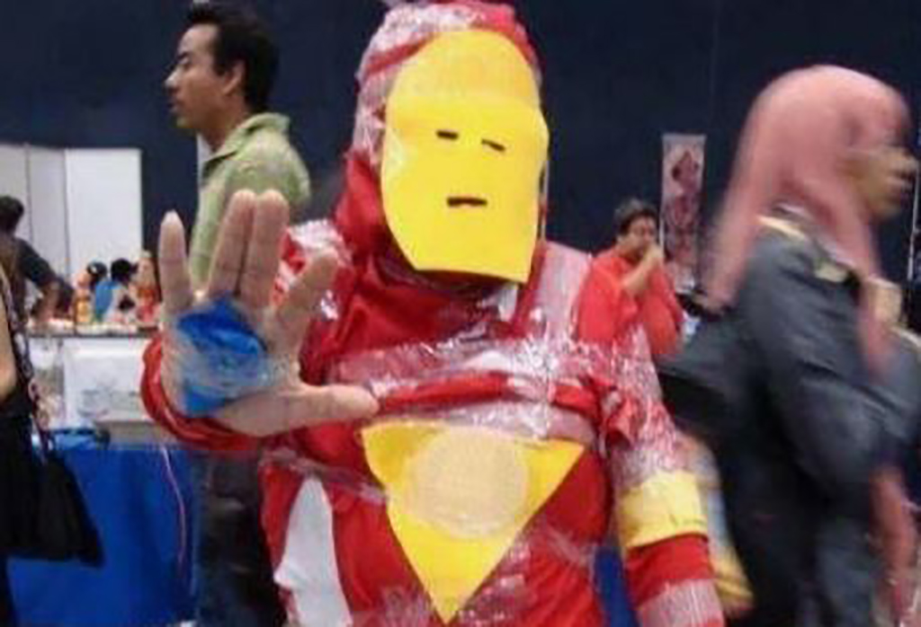 Man dressed in paper as Iron Man