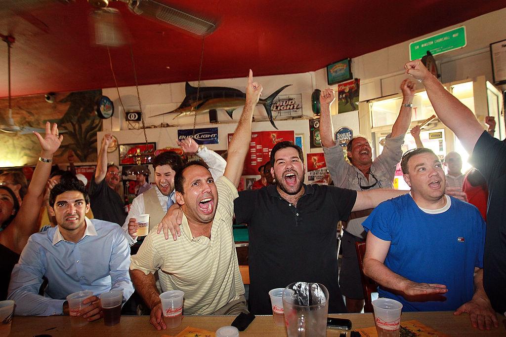 cheering on at the bar