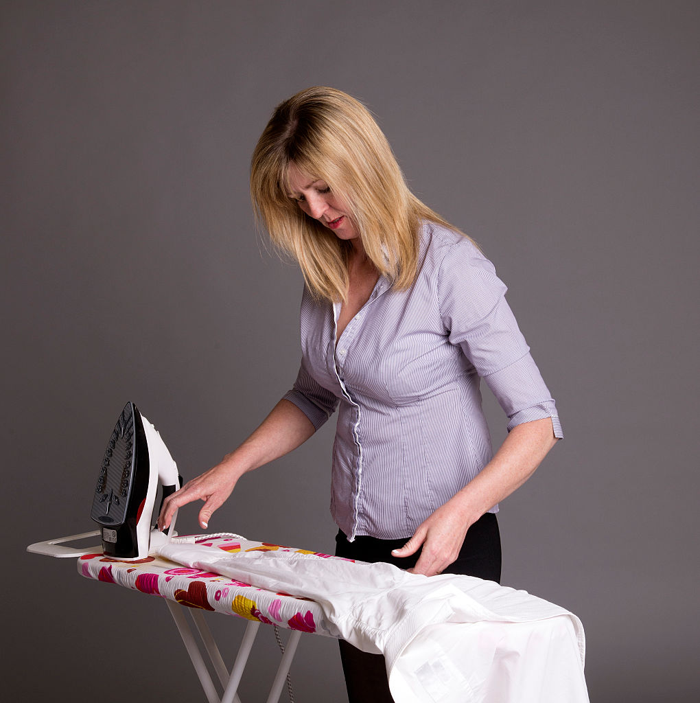 GettyImages-590685287Woman ironing a shirt.