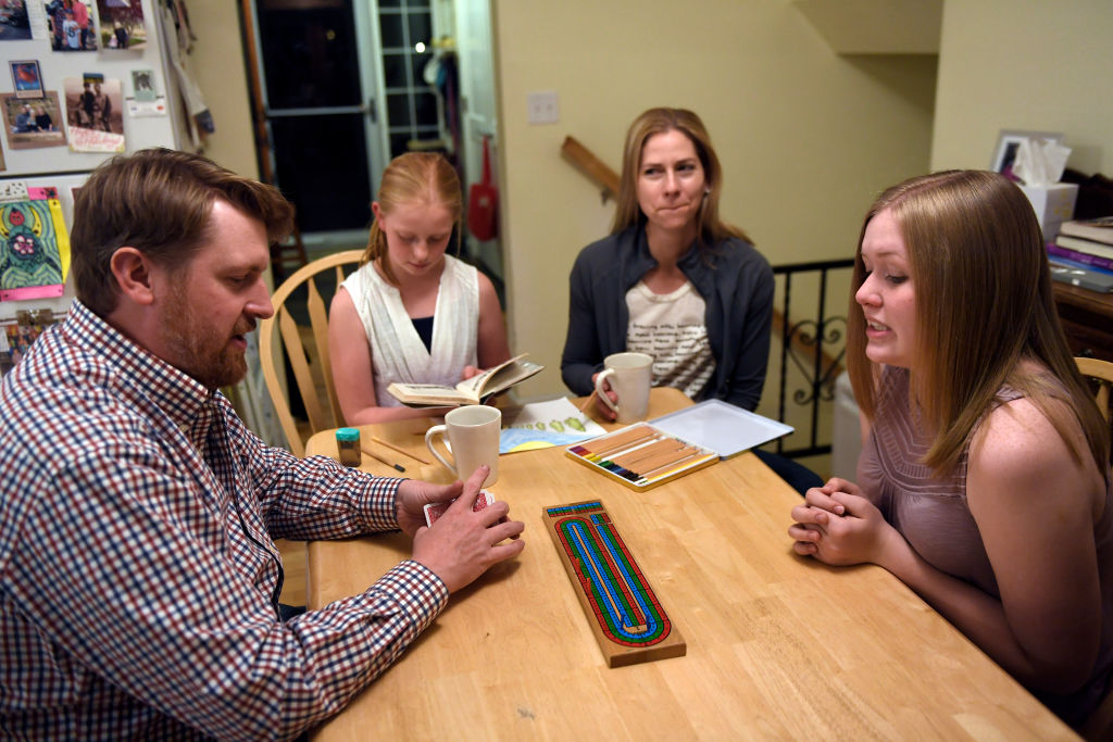 a family playing cribbage together