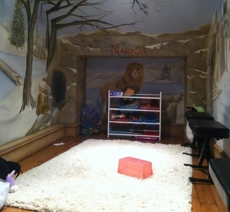 A small play room is painted to look like Narnia.