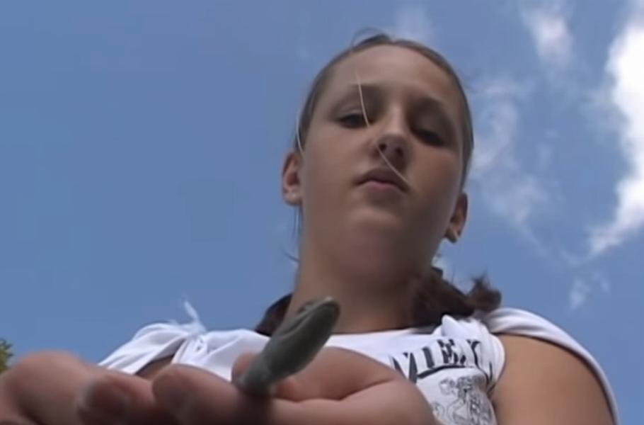 girl holding a snake she found