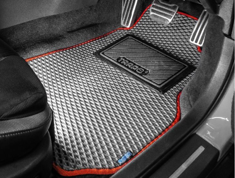 A floormat of a car is seen.