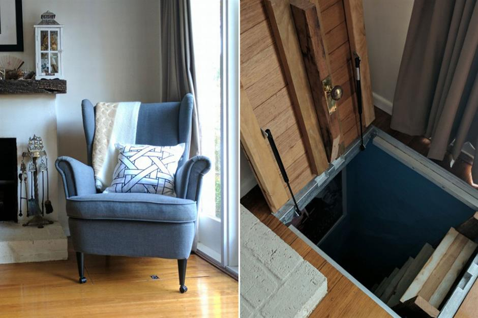 A chair sits over a secret door in the floor that leads to a ladder.