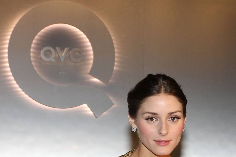 woman in front of qvc logo