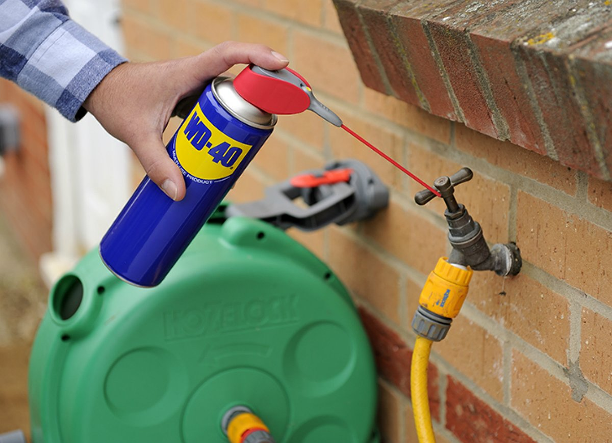 wd-40 being sprayed on pipes