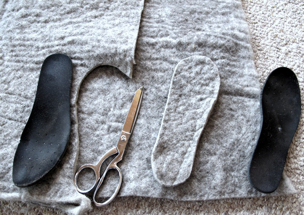 wool cut out to put inside shoe insoles with a pair of metal scissors